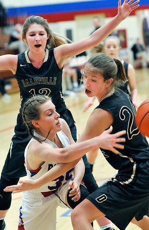 John P. Cleary |  The Herald Bulletin<br /> Elwood's Maleah Ruder finds an outlet pass while being pressured by Daleville's Evy Halbert and Heather Pautler.