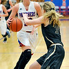 John P. Cleary |  The Herald Bulletin<br /> Elwood's Gabby Leavell makes a cut against Daleville's Ashlyn Craig as she drives the lane.