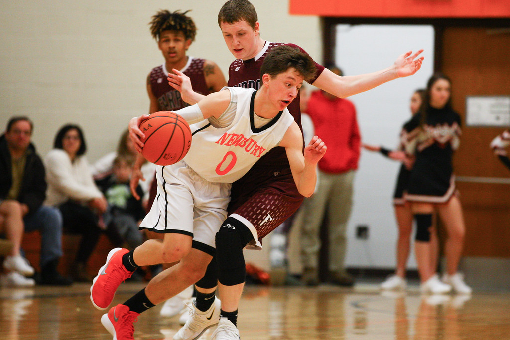 . David Turben - The News-Herald 2017 - Basketball - Fairport at Newbury.  Newbury defeated Fairport 55-54.  Newbury\'s Mario Puletti (0) works to get around Newbury defender Kaleb Grubbs (1).