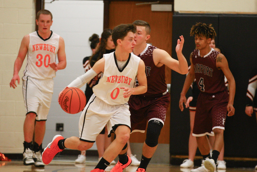 . David Turben - The News-Herald 2017 - Basketball - Fairport at Newbury.  Newbury defeated Fairport 55-54.  Newbury\'s Mario Puletti (0) works the offense.