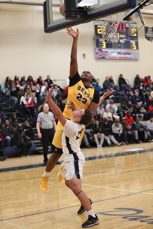 . Tim Phillis - The News-Herald Photos from the Brush vs. Solon game on Dec. 27, 2017 at Garfield Heights.