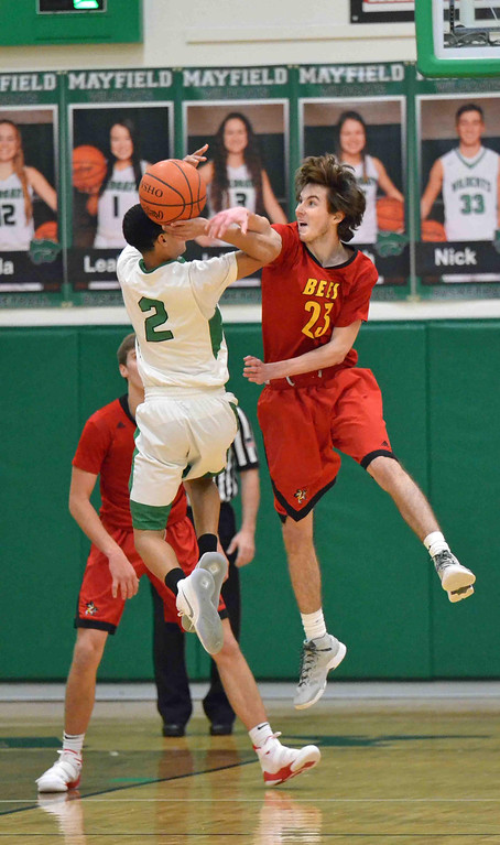 . Patrick Hopkins - The News-Herald  Mayfield Senior, Jalyn Blade (2), gets hit on the arm while attempting to shoot over Brecksville defender, Jack Winegard (23) on Dec 27.
