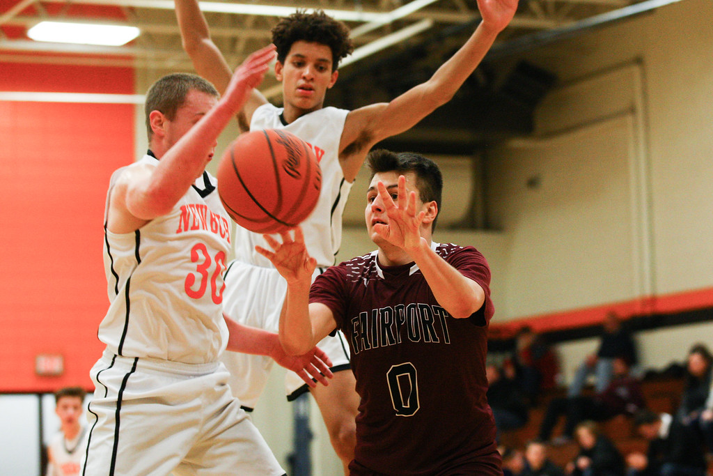 . David Turben - The News-Herald 2017 - Basketball - Fairport at Newbury.  Newbury defeated Fairport 55-54.  Fairport\'s K Carrabine (0) makes a pass surrounded by Newbury defenders