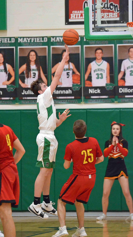 . Paul DiCicco - The News-Herald Mayfield Senior, Dillon Coffey, floats a shot toward the hoop against Brecksville on Dec 27.