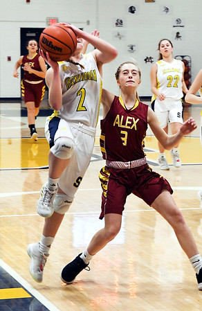 John P. Cleary | The Herald Bulletin<br /> Shenandoah's Kathryn Perry gets a step on Jada Stansberry as she drives the lane for a shot.