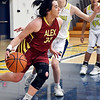 John P. Cleary | The Herald Bulletin<br /> Alexandria's Kenzie Andrew turns back from the baseline as Shenandoah's Jenna Stewart cut off her driving lane.