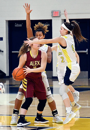 John P. Cleary | The Herald Bulletin<br /> Alexandria's Kirsten VanHorn has a hard time finding a teammate to pass the ball to as the Shenandoah defense was swarming.