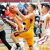John P. Cleary |  The Herald Bulletin<br /> Alexandria's Matthew Hensley goes up the a shot as he drives the lane between defenders.