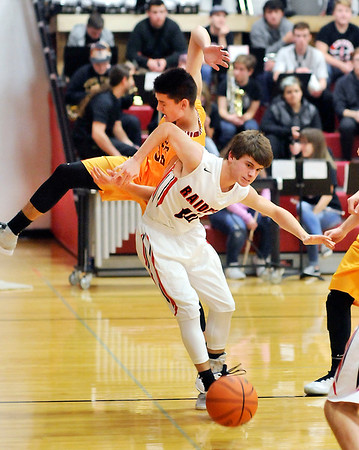 John P. Cleary |  The Herald Bulletin<br /> Wapahani's Jarrett Randolph puts a hip-check on Alexandria's Avery Paddock as they are going after a loose ball.