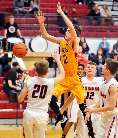 John P. Cleary    The Herald Bulletin<br /> Alexandria's Austin Paddock looses the ball as he drives to the basket.