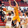 John P. Cleary |  The Herald Bulletin<br /> Alexandria's Austin Paddock looses the ball as he drives to the basket.