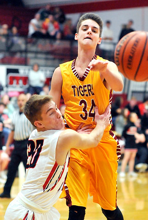 John P. Cleary |  The Herald Bulletin<br /> Alexandria's Avery Paddock passes the ball as he's being hand-checked by Wapahani's Garett Stanley.