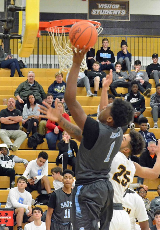 . Paul DiCicco - The News-Herald South�s Devanaire Concliffe puts back a missed shot in the third quarter on Dec. 28.