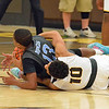 Paul DiCicco - The News-Herald<br /> South's Jaylen Jenkins and Brush's Brandon Stinnet fight for a loose ball on Dec. 28.