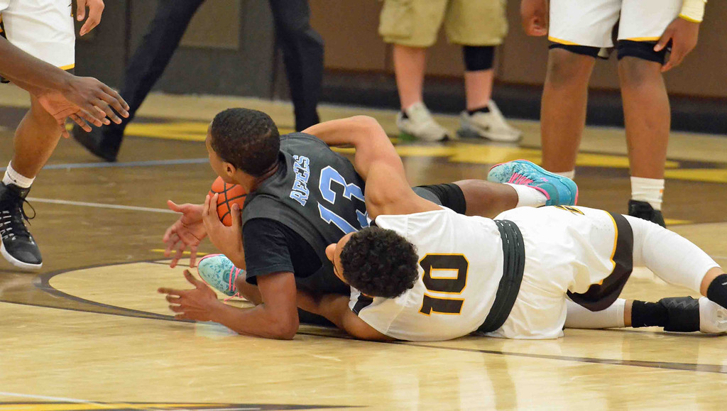 . Paul DiCicco - The News-Herald South\'s Jaylen Jenkins and Brush�s Brandon Stinnet fight for a loose ball on Dec. 28.