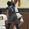 Paul DiCicco - The News-Herald<br /> South Devanaire Concliffe fouls a Brush player near the hoop on Dec. 28.