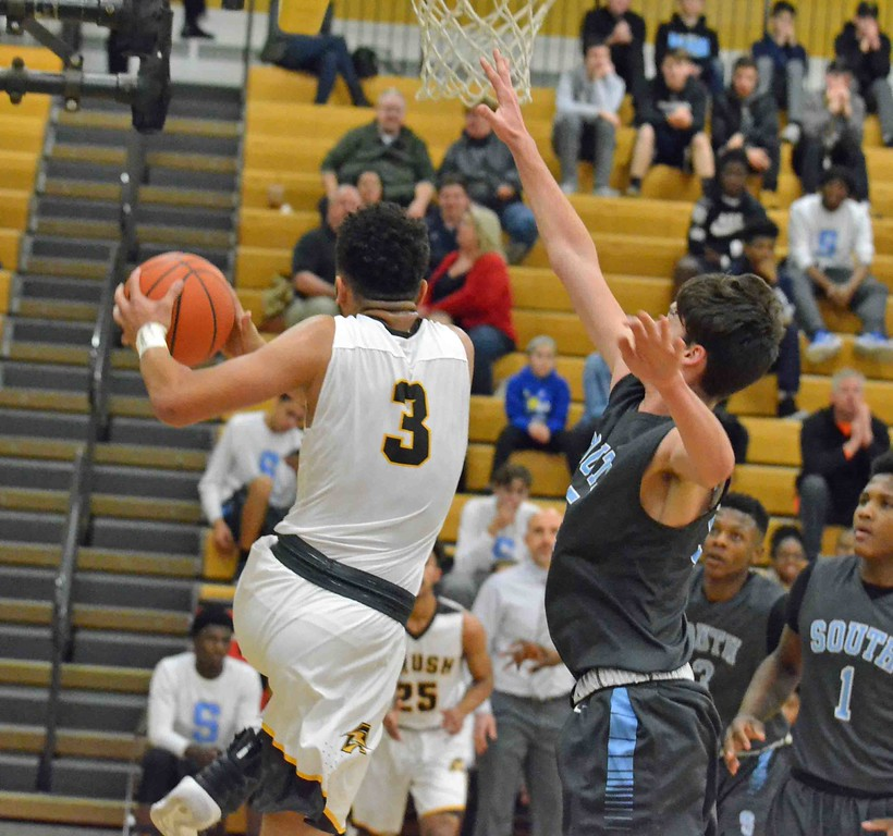 . Paul DiCicco - The News-Herald Brush�s Tyler Williams drives for a reverse layup against South on Dec. 28.