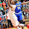 John P. Cleary |  The Herald Bulletin<br /> Anderson's JoMel Boyd drives the lane and puts up a shot as Carmel's Jalen Whack tries to defend.