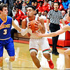 John P. Cleary |  The Herald Bulletin<br /> Anderson's Ethen Russell splits Carmel defenders, Cole Jenkins and Alex Jackson, as he drives  toward the basket.