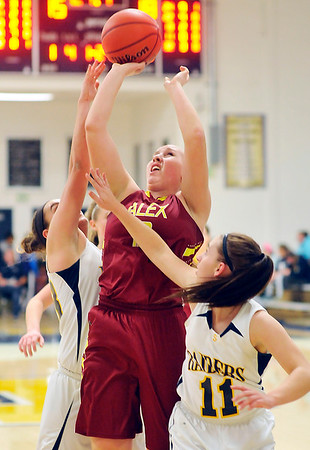 John P. Cleary    The Herald Bulletin<br /> Alexandria's Mackenzie McCarty goes up between defenders for a shot in the lane.