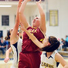 John P. Cleary |  The Herald Bulletin<br /> Alexandria's Mackenzie McCarty goes up between defenders for a shot in the lane.