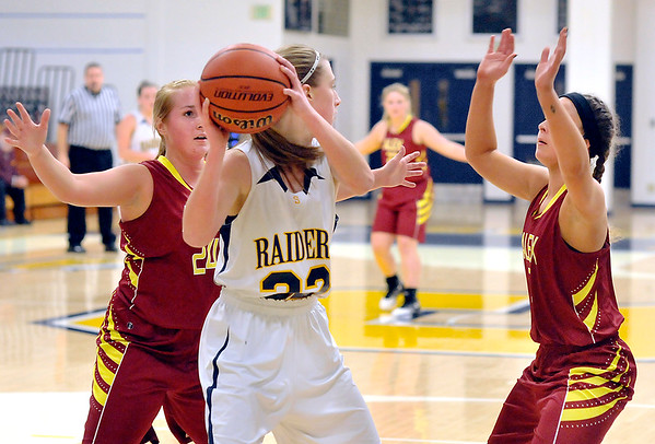John P. Cleary |  The Herald Bulletin<br /> Alexandria's Taylor Jones and Allison Airman put backcourt pressure on Shenandoah's Hillery Shepherd as she tries to bring the ball up court.