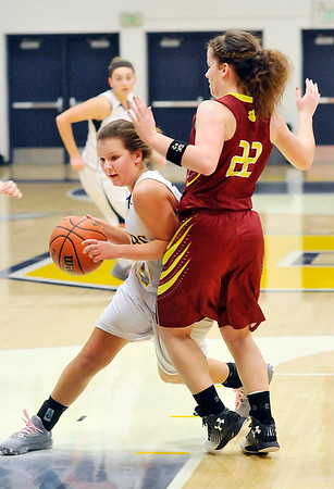 John P. Cleary    The Herald Bulletin<br /> Shenandoah's Rachel Coers drives around Alexandria's  Blaine Kelly as she tries to force her out of the lane.