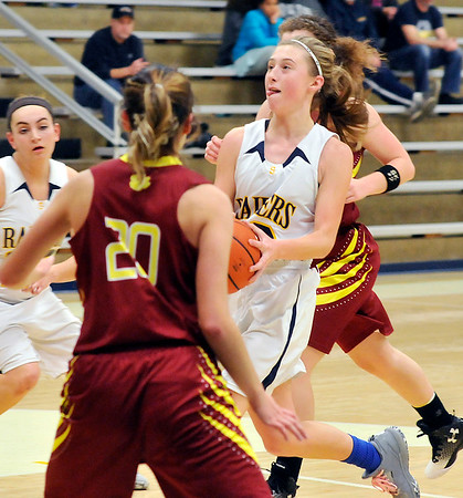 John P. Cleary |  The Herald Bulletin<br /> Shenandoah's Hillery Shepherd drives the lane between Alexandria defenders.