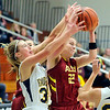 John P. Cleary |  The Herald Bulletin<br /> Shenandoah's Hillery Shepherd and Alexandria's Blaine Kelly fight for a rebound.