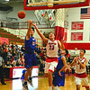 Brittany Chay - The News-Herald<br /> Bay's  R.J. Sunahara defends Mentor's Tadas Tatarunas on Dec. 29 at Mentor