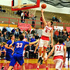 Brittany Chay - The News-Herald<br /> Mentor's Chad Blessing shoots against Bay on Dec. 29 at Mentor