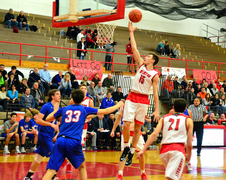 . Brittany Chay - The News-Herald Mentor\'s Chad Blessing shoots against Bay on Dec. 29 at Mentor