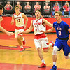 Brittany Chay - The News-Herald<br /> Bay's Erik Painter drives against Mentor on Dec. 29 at Mentor