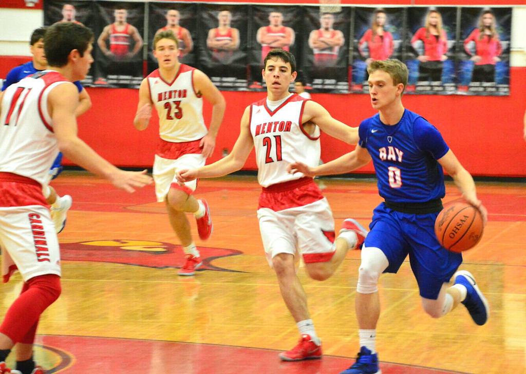 . Brittany Chay - The News-Herald Bay\'s Erik Painter drives against Mentor on Dec. 29 at Mentor