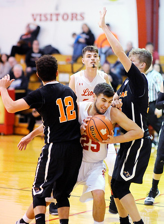 Don Knight    The Herald Bulletin<br /> Liberty Christian's Dallas Burko squeezes between Indiana School for the Deaf defenders from left Joel Dramin and Jared Beckler on Friday.
