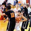Don Knight |  The Herald Bulletin<br /> Liberty Christian's Dallas Burko squeezes between Indiana School for the Deaf defenders from left Joel Dramin and Jared Beckler on Friday.