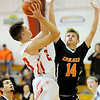 Don Knight |  The Herald Bulletin<br /> Liberty Christian's Joshua Tufts shoots as he is guarded by Indiana School for the Deaf's Jared Beckler on Friday.