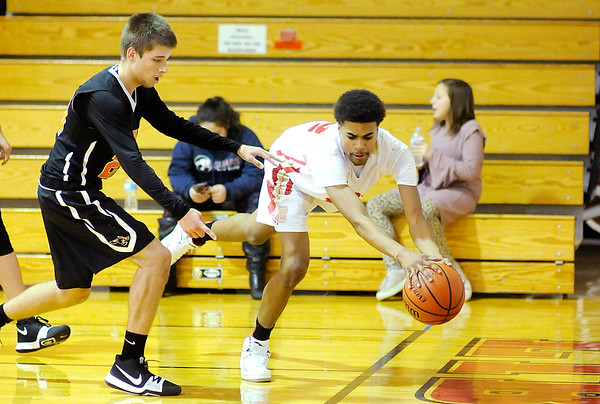 Don Knight    The Herald Bulletin<br /> Liberty Christian's Orlando Sutton saves the ball from going out of bounds as the Lions hosted the Indiana School for the Deaf on Friday.