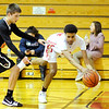 Don Knight |  The Herald Bulletin<br /> Liberty Christian's Orlando Sutton saves the ball from going out of bounds as the Lions hosted the Indiana School for the Deaf on Friday.