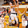 Don Knight |  The Herald Bulletin<br /> Alexandria's Avery Paddock drives for a layup after stealing the ball as the Tigers hosted Delta on Saturday.
