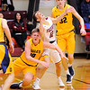 Don Knight |  The Herald Bulletin<br /> Alexandria's Sam Hensley and Delta's Tyler Wilburn collide as they scramble for a loose ball on Saturday.