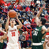 John P. Cleary | The Herald Bulletin<br /> Frankton's Kayden Key goes to the basket as Pendleton's Christian Jones comes in to try to defend.<br /> <br /> First round of Madison County Tourney with Pendleton Heights vs Frankton in boys basketball.