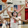 John P. Cleary | The Herald Bulletin<br /> Frankton's Kayden Key gets fouled from behind by Pendleton's Ryan Noel as he attempts a shot from under the basket.