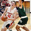 John P. Cleary | The Herald Bulletin<br /> Frankton's Rylan Detling drives to the basket  as Pendleton's Damieon Warrum tries to defend.
