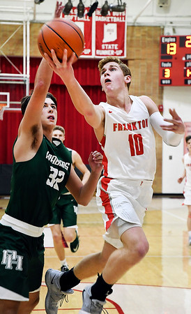 John P. Cleary   The Herald Bulletin<br /> Frankton's Brayton Cain gets a step on Pendleton's Damieon Warrum through the lane and goes up for a shot.