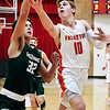 John P. Cleary | The Herald Bulletin<br /> Frankton's Brayton Cain gets a step on Pendleton's Damieon Warrum through the lane and goes up for a shot.