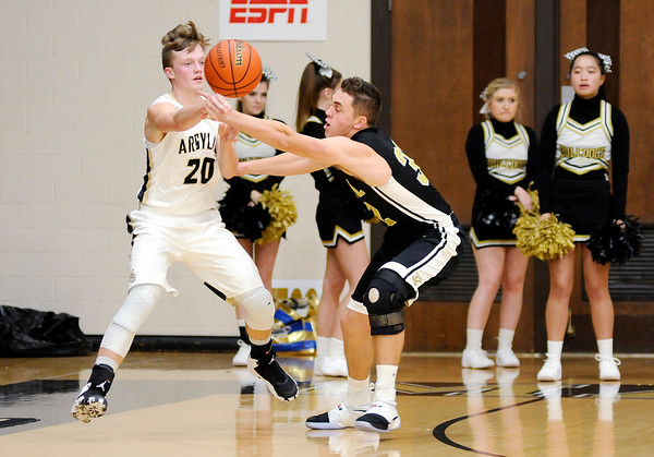 Don Knight | The Herald Bulletin<br /> Madison-Grant's Wyatt Rudy passes the ball as he is guarded by Lapel's Levi Frazier at Madison-Grant on Saturday.