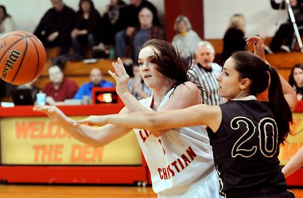John P. Cleary    The Herald Bulletin<br /> Liberty Christian's Kennedy Fillmore flips the ball back out as she is being pressured by Daleville's Krystal Watters.