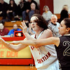 John P. Cleary |  The Herald Bulletin<br /> Liberty Christian's Kennedy Fillmore flips the ball back out as she is being pressured by Daleville's Krystal Watters.