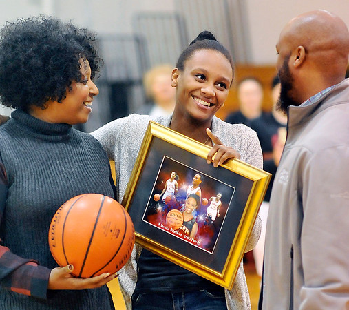 John P. Cleary |  The Herald Bulletin<br /> Liberty Christian senior Monica Watkins was honored Monday evening on being the second Lady Lion to score 1,000 points.
